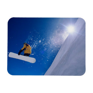 Man flying through the air on a snowboard with rectangle magnet