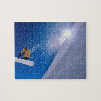 Man flying through the air on a snowboard with puzzle