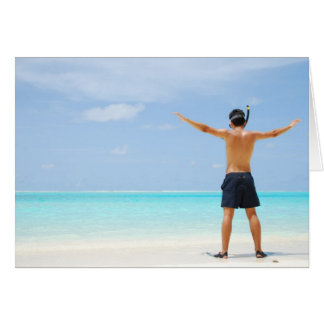 man getting ready to go snorkeling in a tropical i card