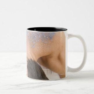 Man getting salt rub Two-Tone coffee mug