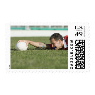 Man grabbing rugby ball postage stamps