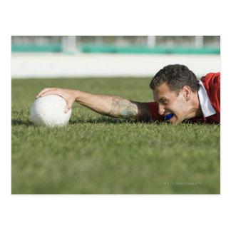 Man grabbing rugby ball postcard