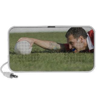 Man grabbing rugby ball iPhone speaker