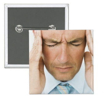 Man hands on head pinback button
