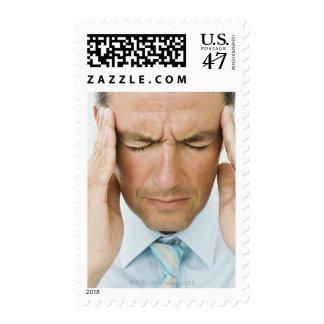 Man hands on head postage