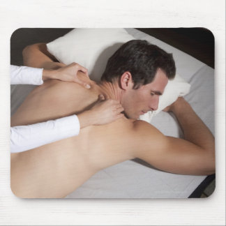 Man having a back massage from woman mouse pad