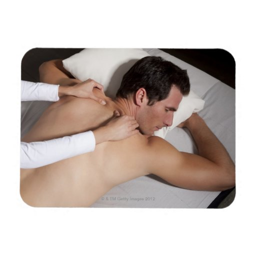 Man having a back massage from woman rectangle magnet