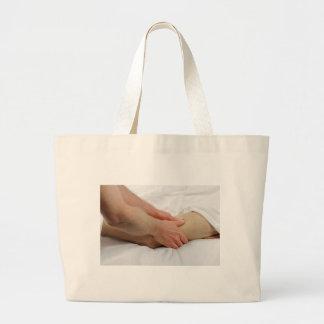 Man Having Leg Massage Large Tote Bag