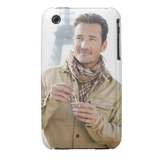 Man holding a disposable cup with the Eiffel iPhone 3 Case-Mate Cases