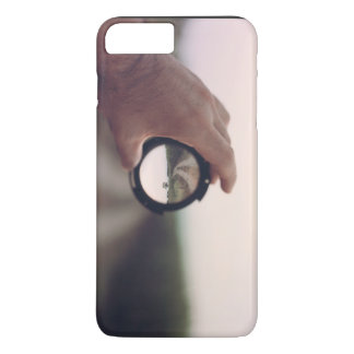 Man holding a lens that shows inverted image iPhone 7 plus case
