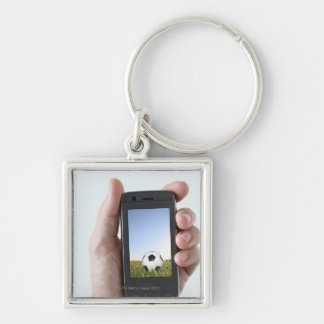 Man holding a mobile phone Silver-Colored square keychain