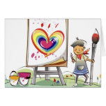 Man holding a paintbrush and standing by an easel greeting card