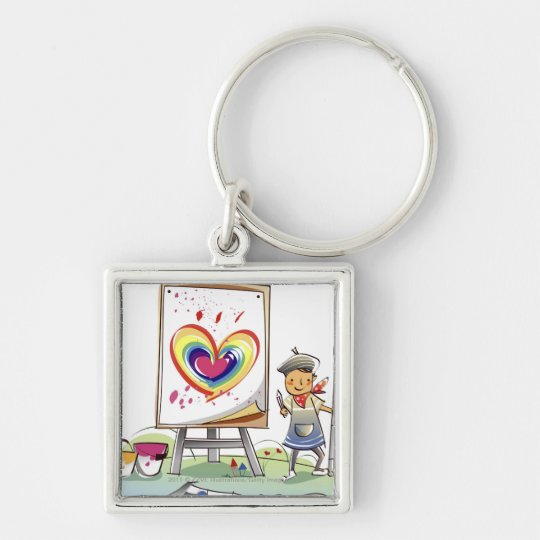 Man holding a paintbrush and standing by an easel keychain