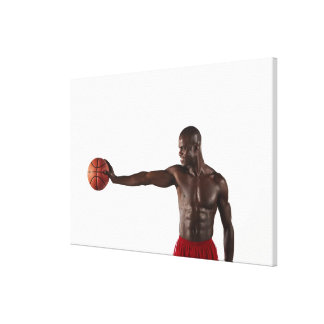 Man holding basketball stretched canvas prints