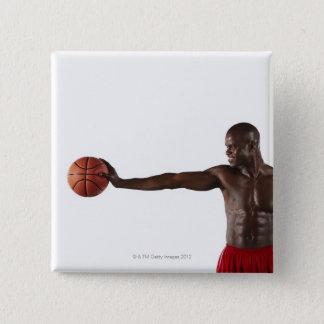 Man holding basketball pinback button
