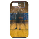 Man holding basketball standing on court, iPhone 5 cover