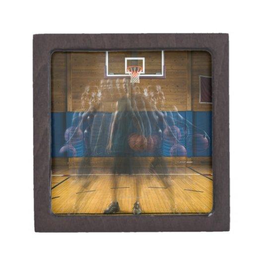 Man holding basketball standing on court, jewelry box