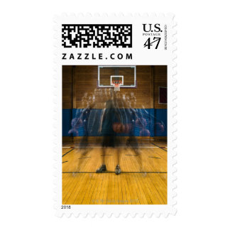 Man holding basketball standing on court, postage