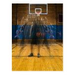 Man holding basketball standing on court, postcard