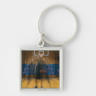 Man holding basketball standing on court, Silver-Colored square keychain