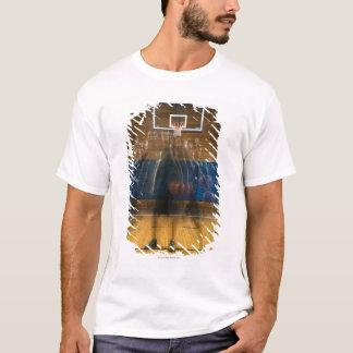 Man holding basketball standing on court, T-Shirt