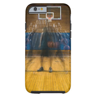 Man holding basketball standing on court, tough iPhone 6 case