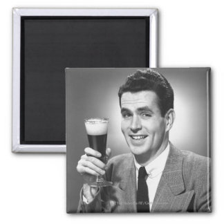 Man holding glass of beer in studio B&W Magnet