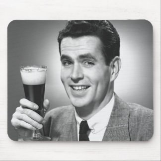 Man holding glass of beer in studio B&W Mousepads