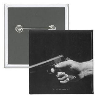 Man Holding Gun Pinback Button