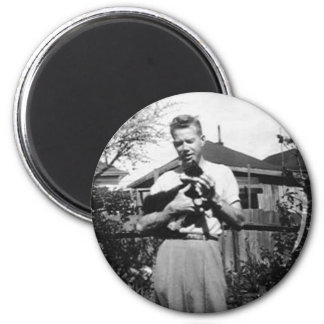 man holding kitty magnets