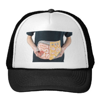 Man holding model of human intestines or bowels trucker hat