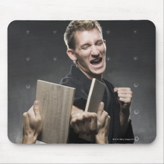 man in a black karate gi practicing martial arts mouse pad