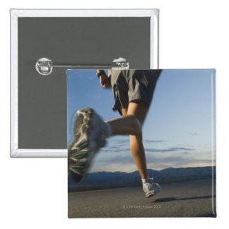 Man in athletic gear running button