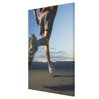Man in athletic gear running canvas print