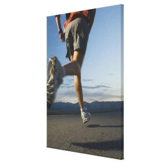 Man in athletic gear running canvas print