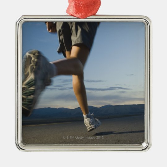 Man in athletic gear running metal ornament