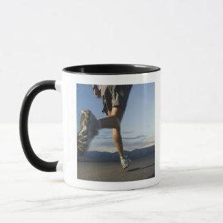 Man in athletic gear running mug