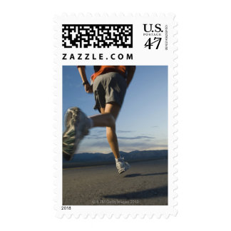 Man in athletic gear running postage