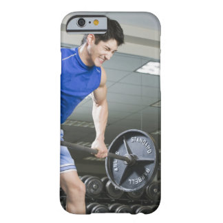 Man in gym, lifting large barbell, clenching barely there iPhone 6 case
