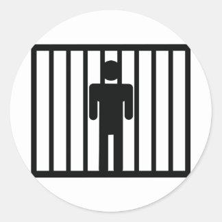 man in jail round sticker