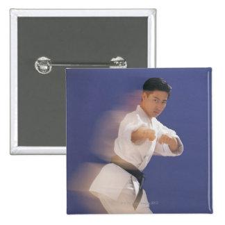 Man in karate stance pins
