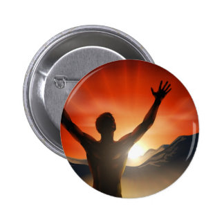 Man in silhouette arms raised on mountain pins