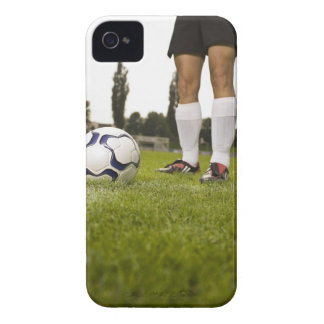 Man in soccer uniform standing with soccer ball Case-Mate iPhone 4 case
