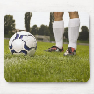 Man in soccer uniform standing with soccer ball mouse pad
