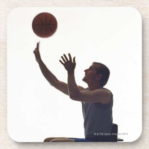 Man in wheelchair playing with basketball beverage coaster