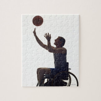 Man in wheelchair playing with basketball jigsaw puzzle