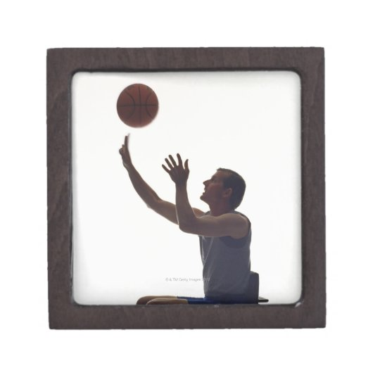 Man in wheelchair playing with basketball keepsake box