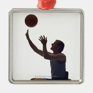 Man in wheelchair playing with basketball metal ornament