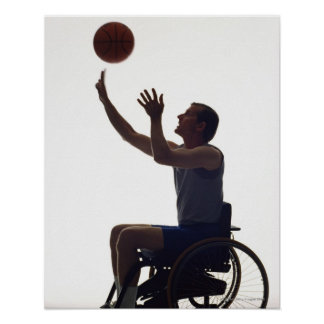 Man in wheelchair playing with basketball poster