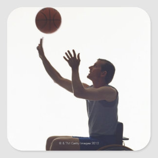 Man in wheelchair playing with basketball square sticker